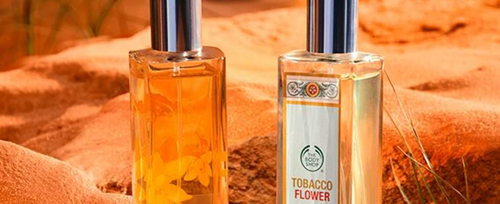 Two The Body Shop perfumes in desert setting