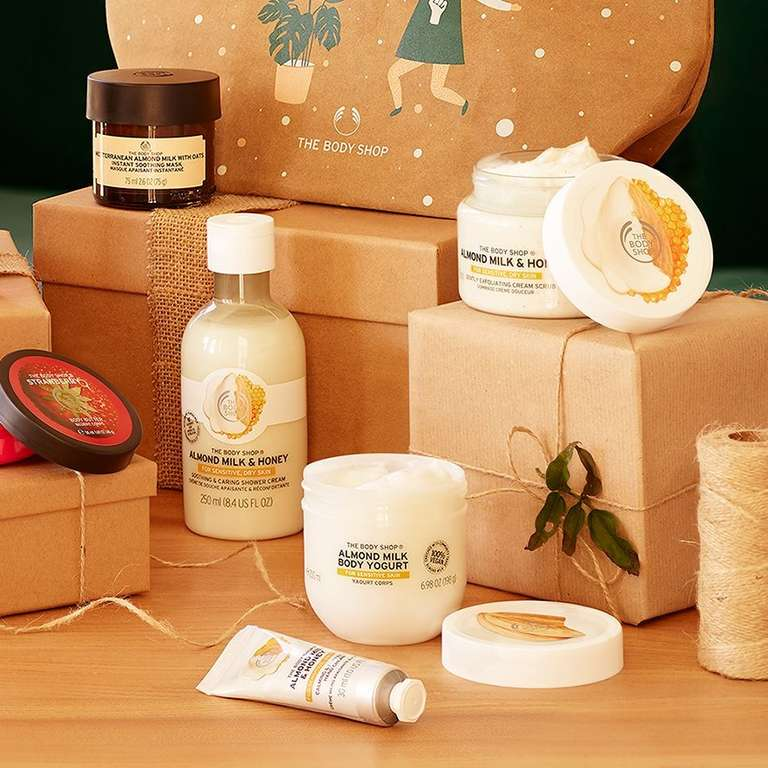 Selection of The Body Shop products on a table, surrounded by brown packaging, string and decorations
