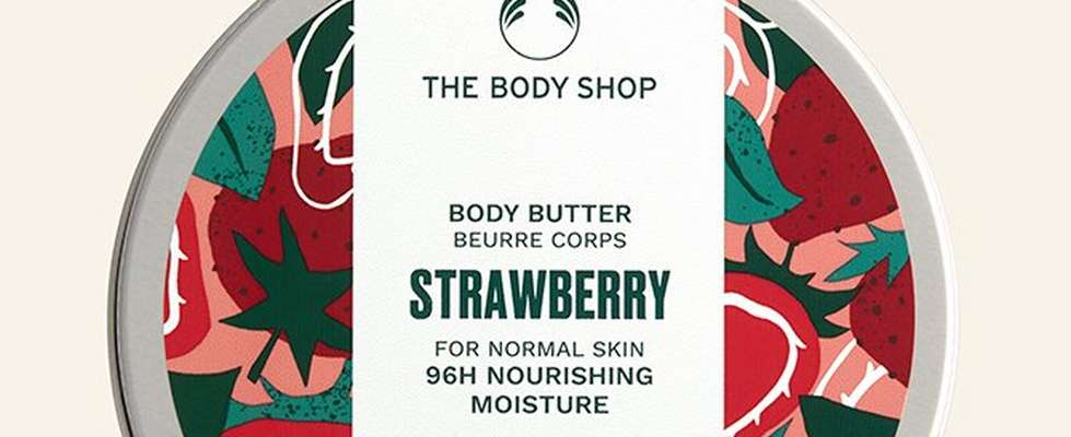 Strawberry body butter against beige background