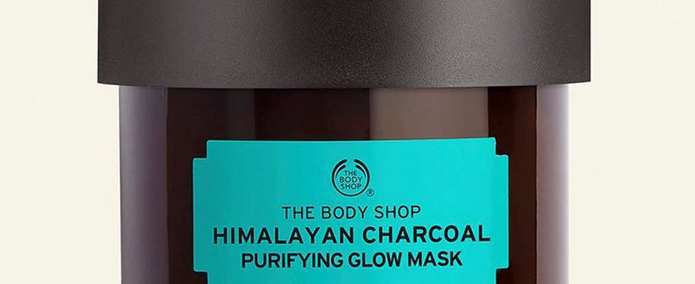 Himalayan charcoal purifying glow mask against beige background