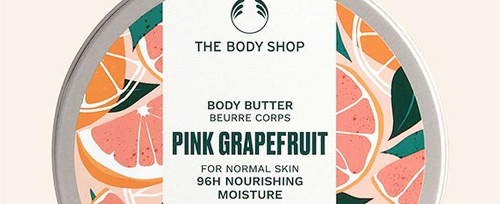 Pink grapefruit body butter against beige background