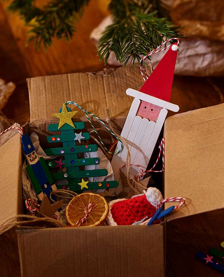 Recycled brown boxes and paper with a selection of handmade Christmas decorations in and around it