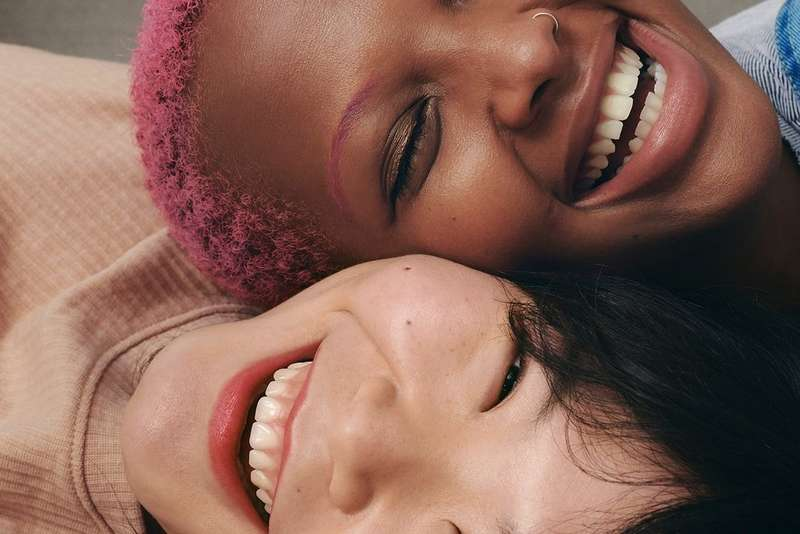 Two models laughing together