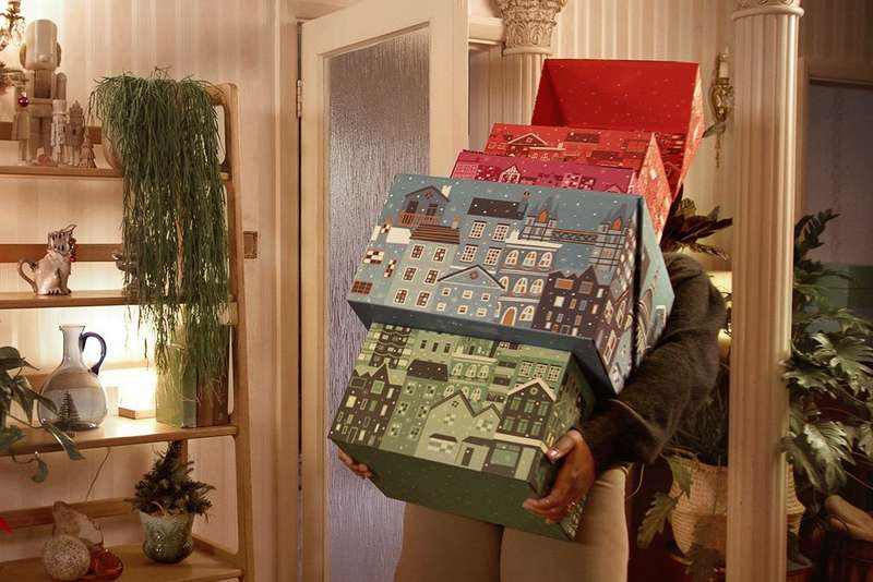 Person holding advent calendars