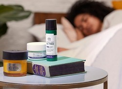 Woman sleeping with favourite night time products