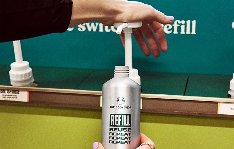 Hand pumping a refill bottle