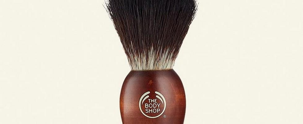 Shaving brush against beige background