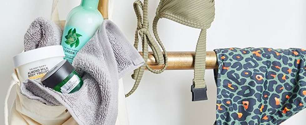 Gym clothes hung on a gold railing