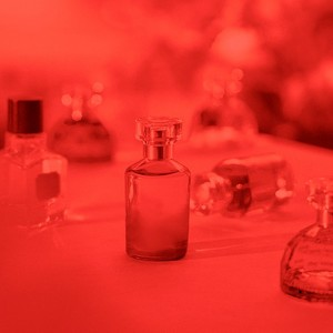 Selection of fragrance bottles with red filter overlay