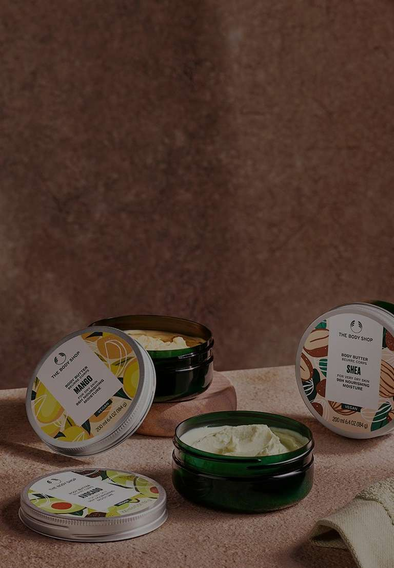 Selection of body butters with their lids off