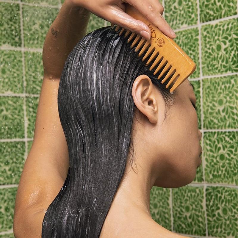 WOMEN COMBING HAIR IN SHOWER