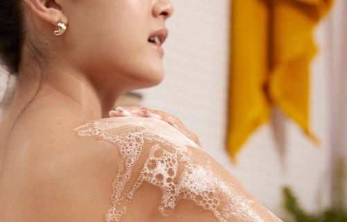 Woman using shower gel