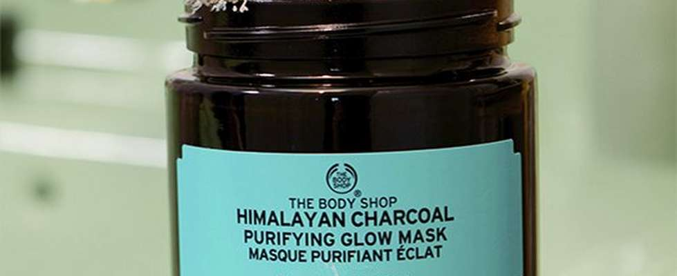 Himalayan Charcoal Mask on green bathroom sink