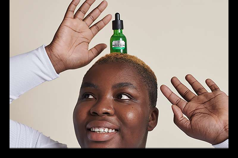 lady with product balanced on her head