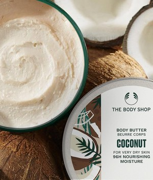 The Body Shop Coconut Body Butter tub on sink