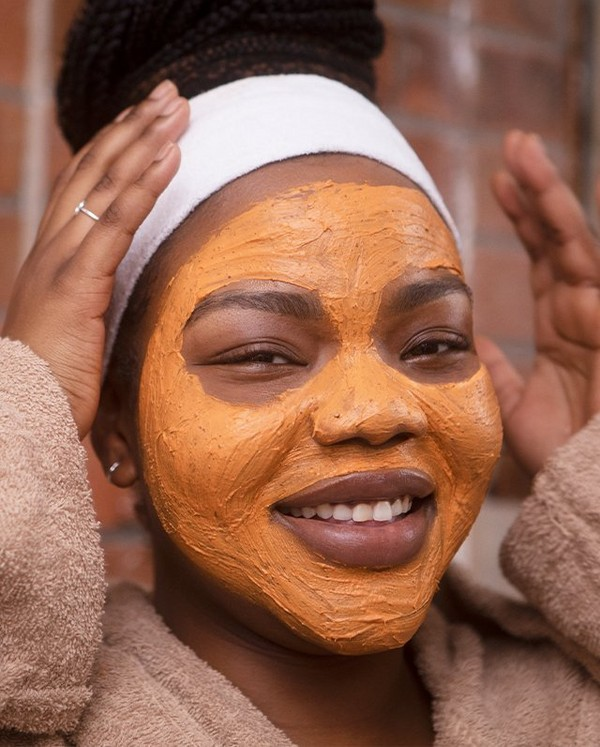 Woman using Vanilla Pumpkin face mask