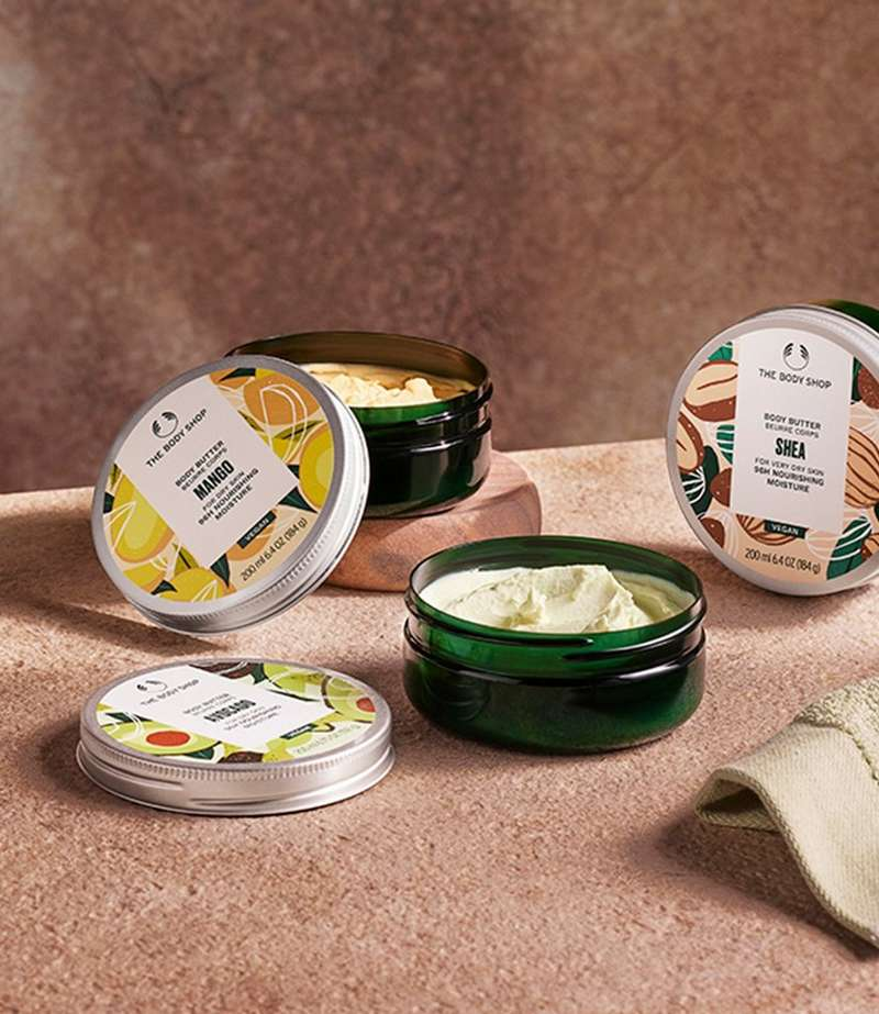 Selection of body butters with the lids off