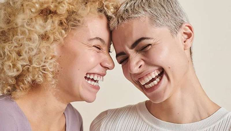 TWO LADIES LAUGHING