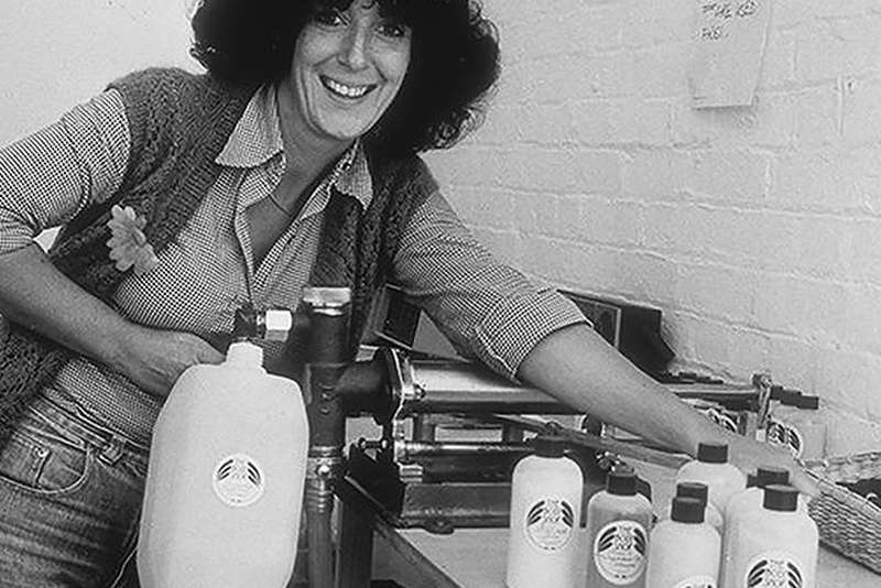 Picture of Anita Roddick with The Body Shop products