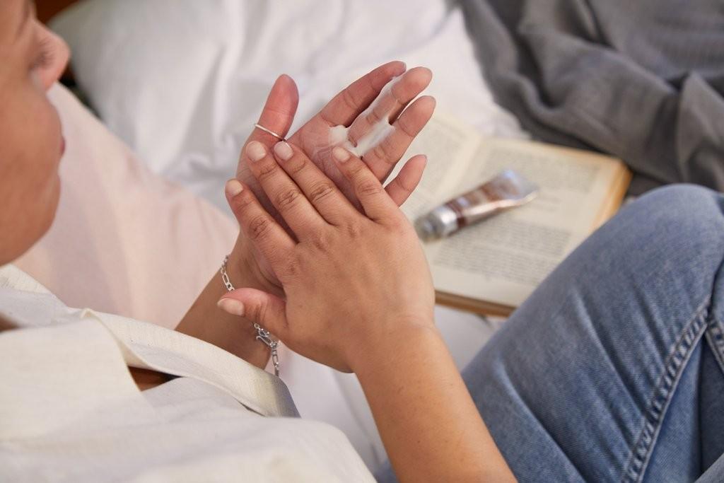 Woman rubbing in hand cream
