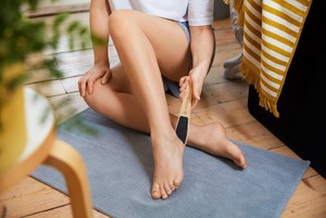 Woman using foot file