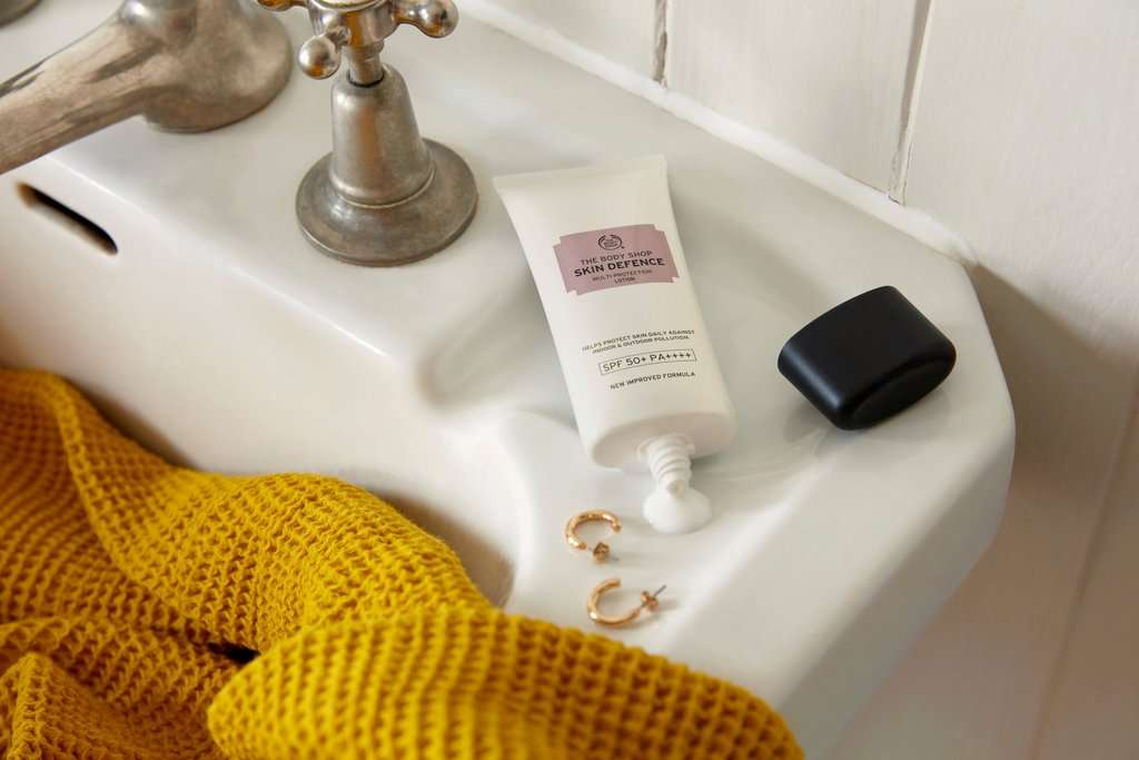 The Body Shop Skin Defence Lotion on bathroom sink