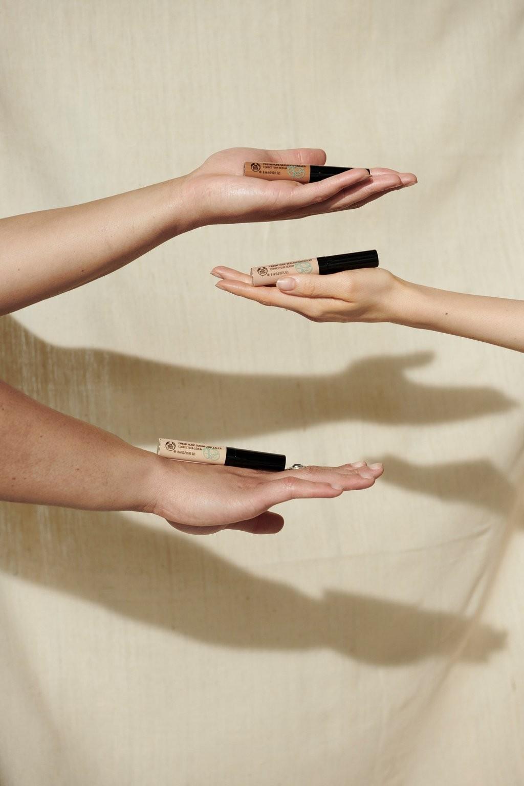 Hands holding The Body Shop Concealer