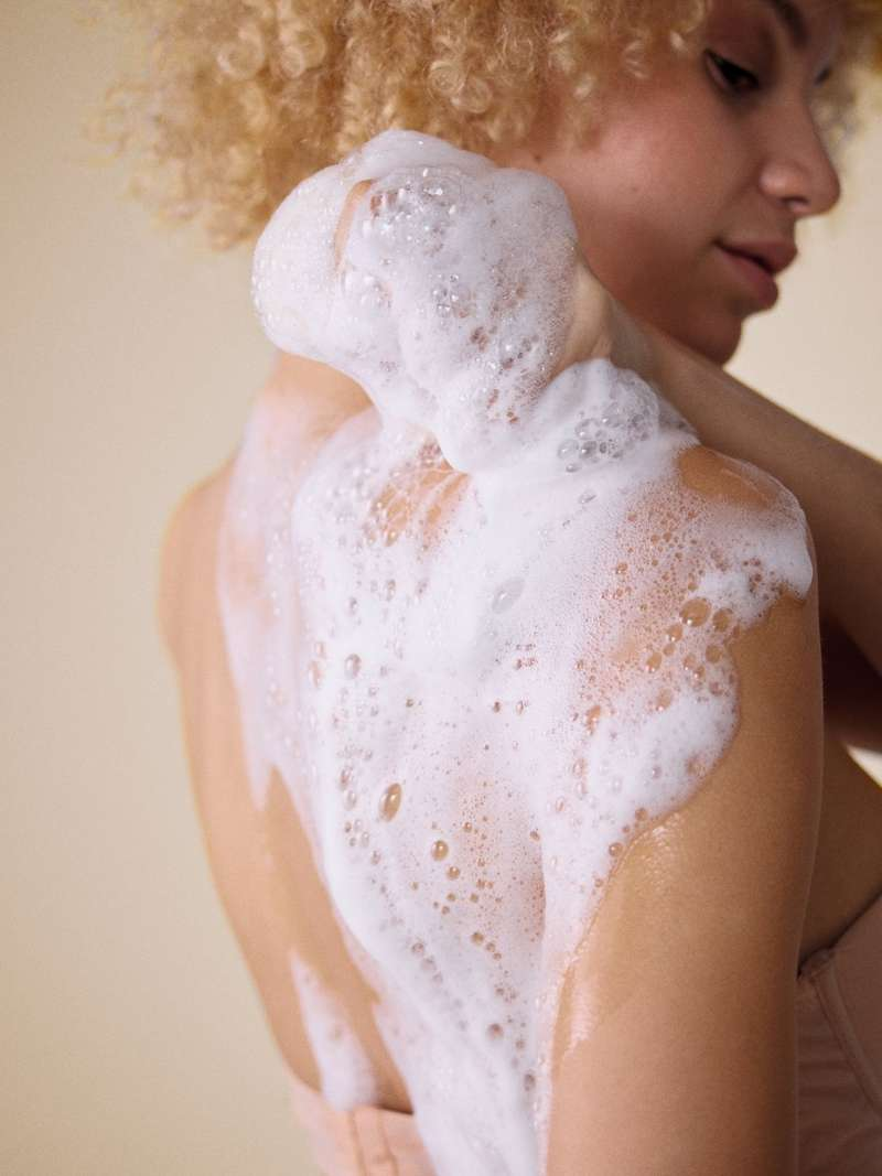 Woman using foaming wash