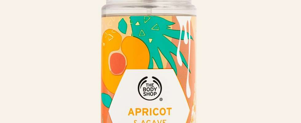 Apricot and agave hair and body mist against beige background