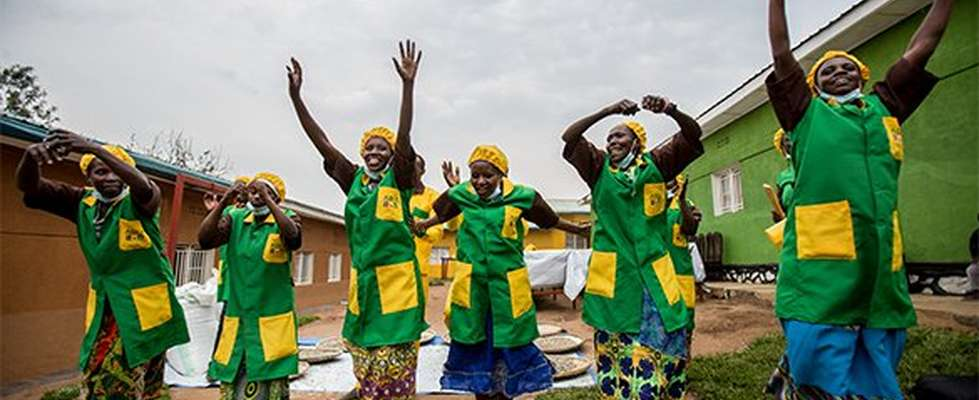 group of women with their hands up