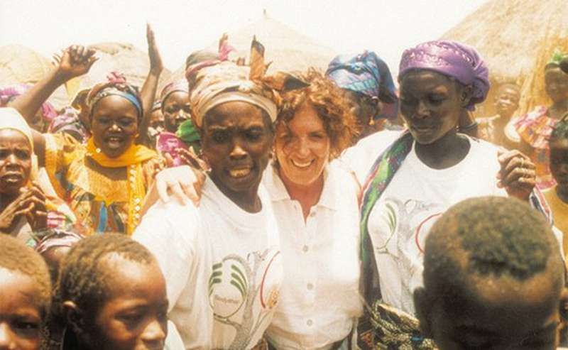 Anita Roddick in the centre of a group of woman