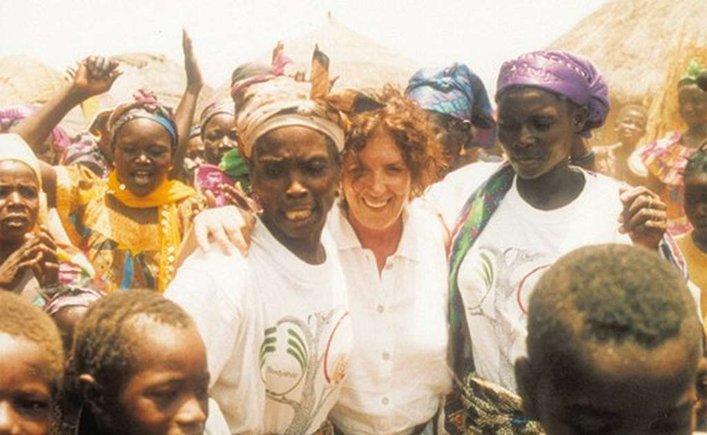 Anita Roddick in a croud of women