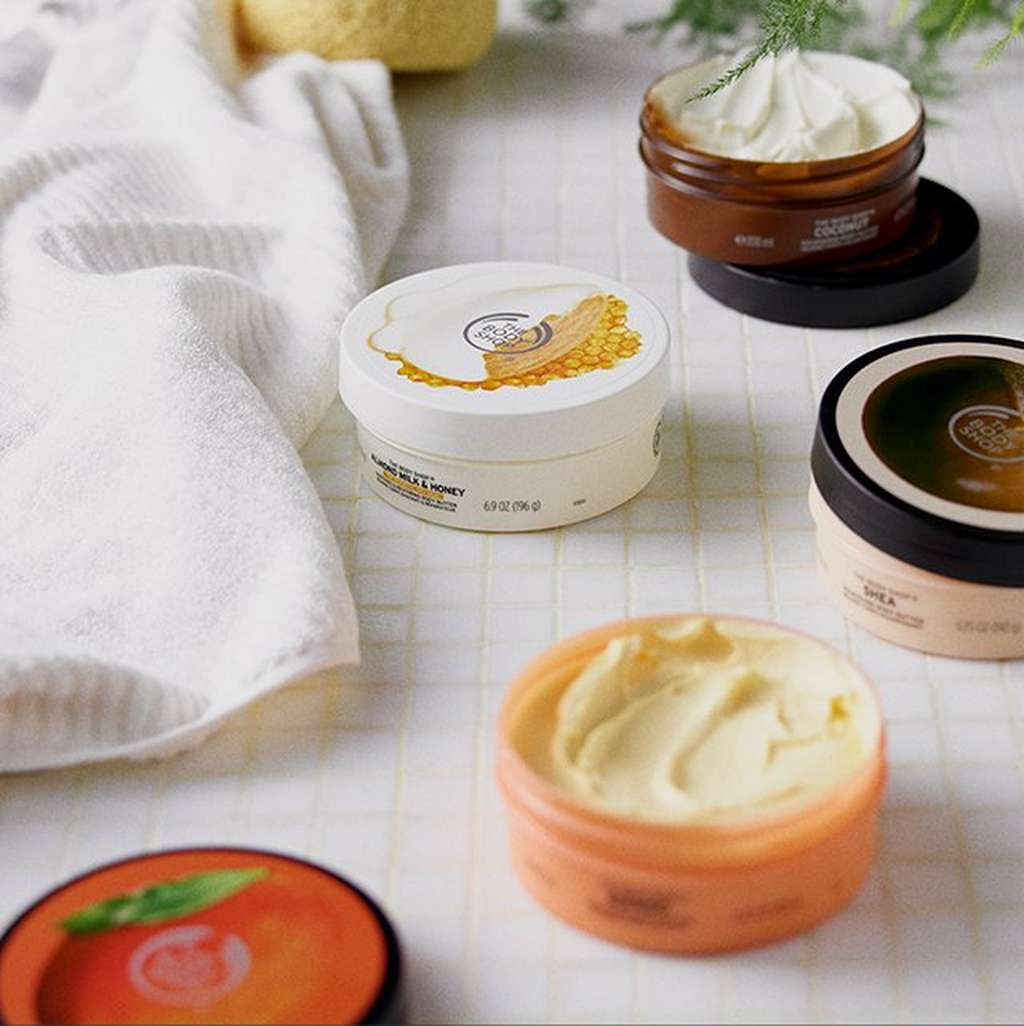 Opened body butter tubs
