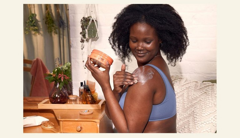 Woman applying body butter