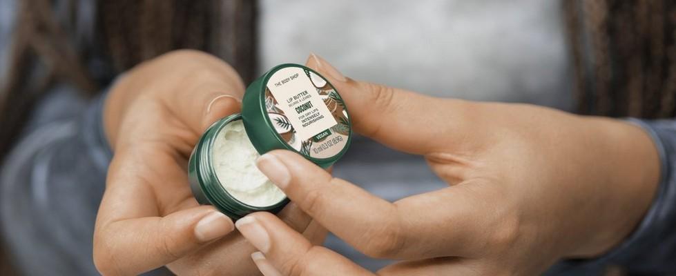 Woman applying lip butter
