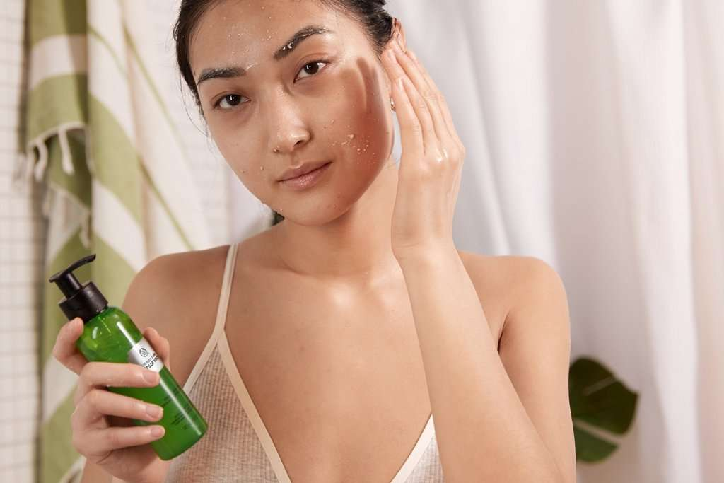 Woman applying liquid peel to her face