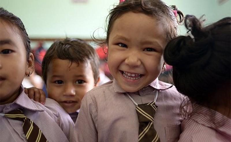 Glimlachende schoolkinderen
