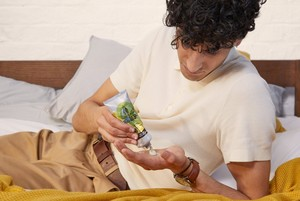 Man applying The Body Shop Hemp Hand Protector