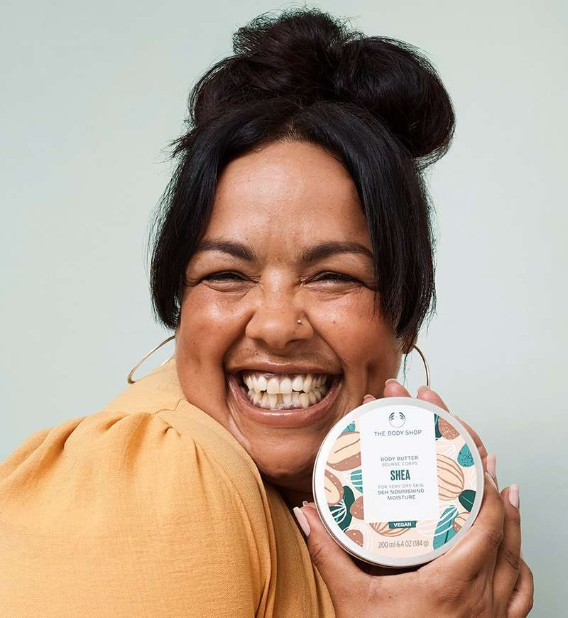 Kerry smiling with The Body Shop body butter