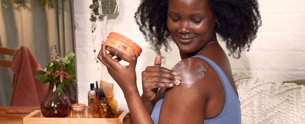 Woman Rubbing Body Butter Into Shoulder