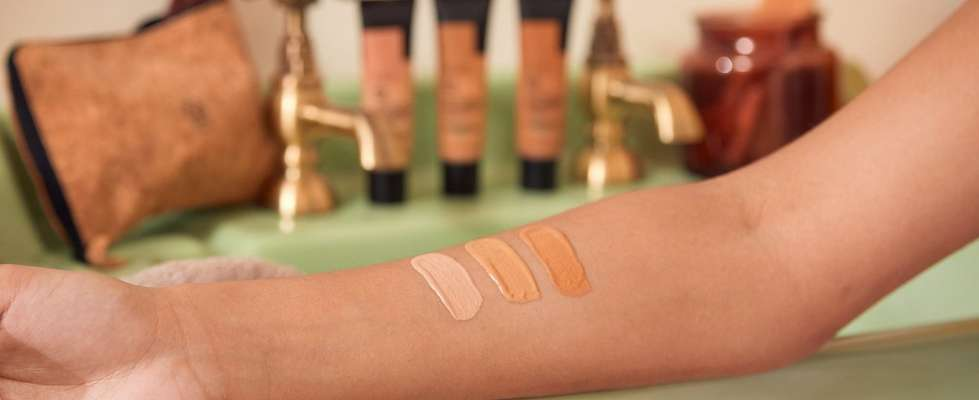 Persons arm testing different makeup colours