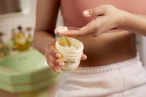 Hand scooping The Body Shop Moringa Body Yogurt