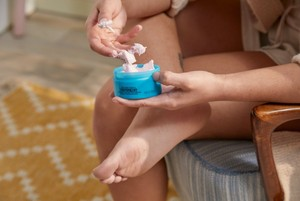 Person applying The Body Shop Peppermint Foot Rescue
