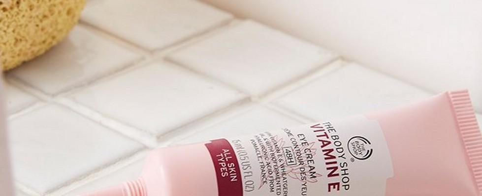 Vitamin E eye cream on white bathroom tiles