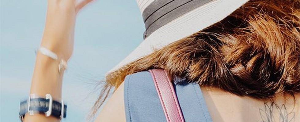 Model wearing a hat in the sun