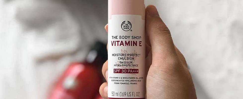 Hand holding Vitamin E Day Cream