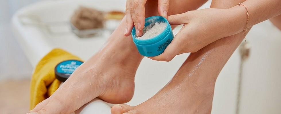 Foot scrub application in the bath