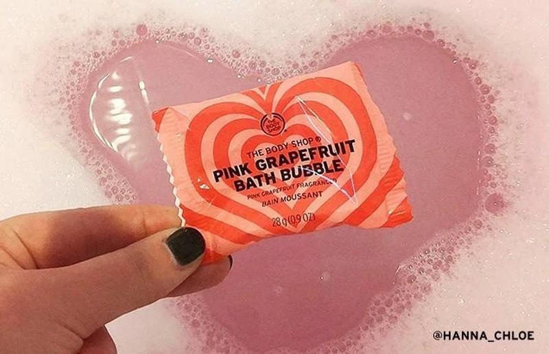 Hand Holding The Body Shop Pink Grapefruit Bath Bubble