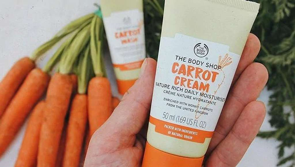 HAND HOLDING BODY SHOP CARROT CREAM
