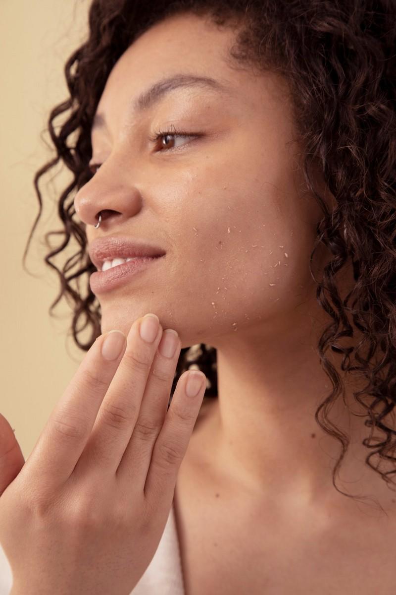 Woman using facial liquid peel